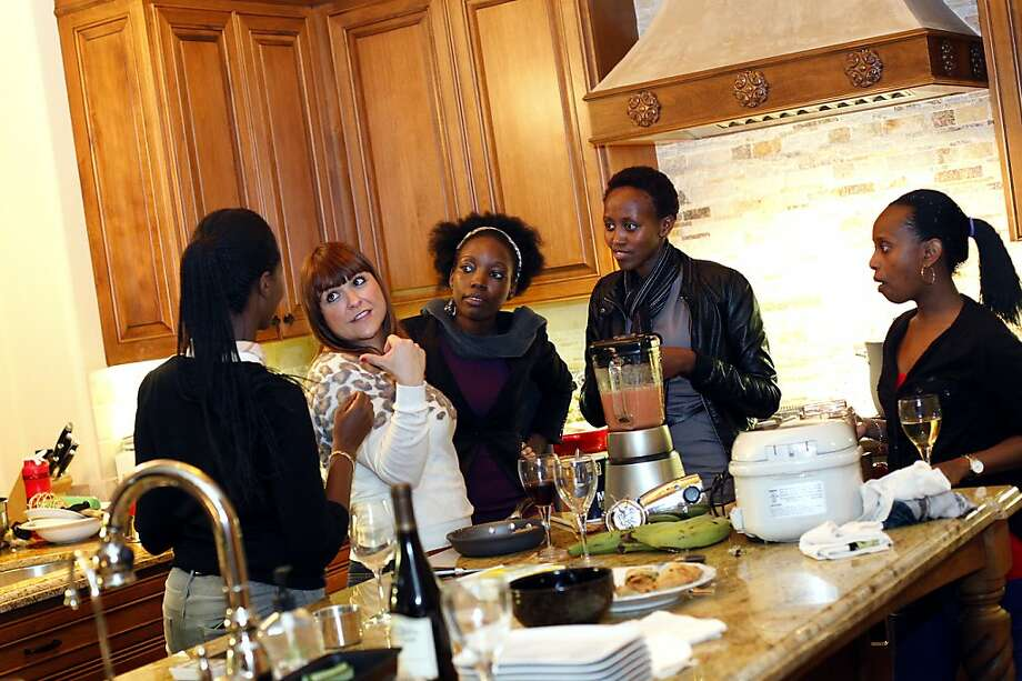 Angel Bisamaza (right), Guillaine Neza, Emma Marie Ndoringoma and Erica Lockheimer gather for dinner in San Jose. Photo: Sarah Rice, Special To The Chronicle