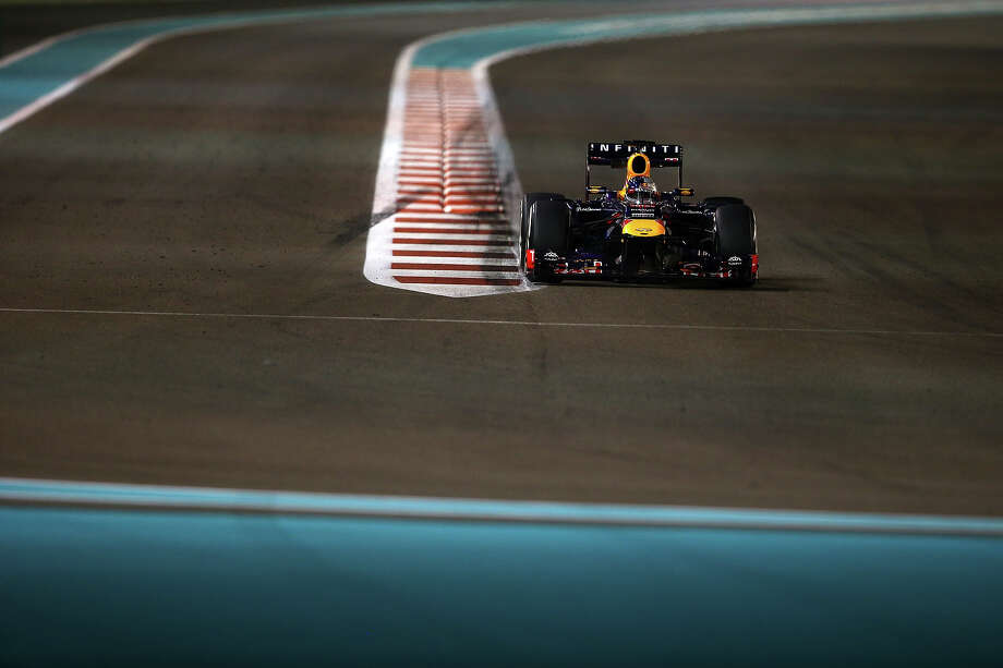 Sebastian Vettel of Germany and Infiniti Red Bull Racing drives during practice for the Abu Dhabi Formula One Grand Prix at the Yas Marina Circuit on November 1, 2013 in Abu Dhabi, United Arab Emirates. Photo: Paul Gilham, Getty Images / 2013 Getty Images
