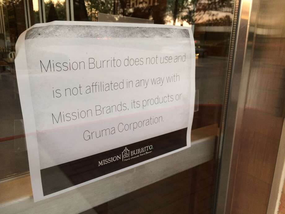 A sign posted in the window of the Mission Burritos in Sugar Land, Oct. 31, 2013. (Cory Heikkila / Houston Chronicle)