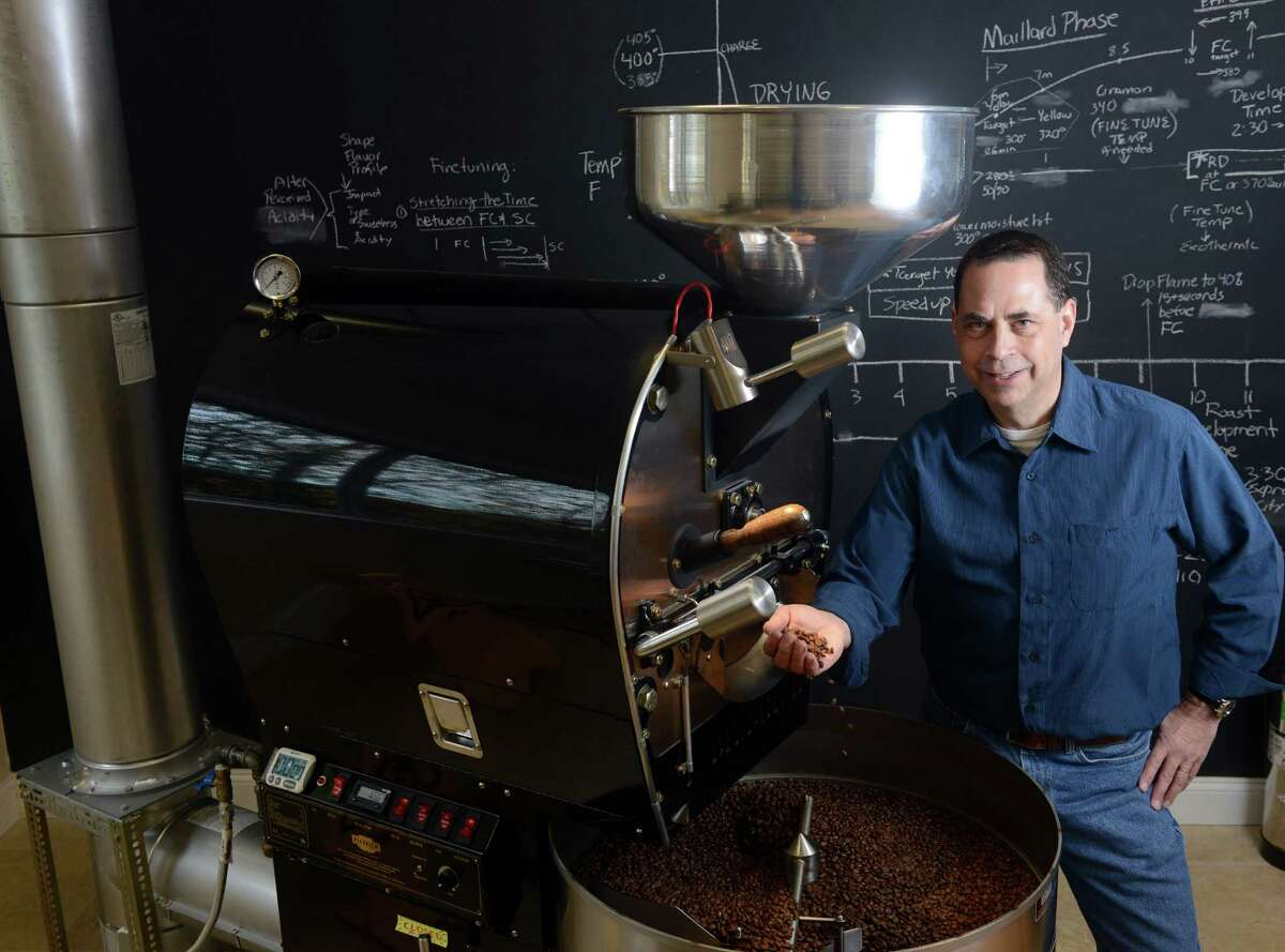 Ed Freedman stands beside his Diedrich Roaster at Shearwater Organic Coffee Roasters LLC in Trumbull, Conn. Shearwater is the first and only USDA certified Organic Coffee Roaster in Fairfield County.