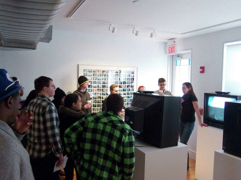 """Franklin Street Works Creative Director Terri C Smith gives a tour of the exhibition, """"Your Content Will Return Shortly,"""" to new media students at SUNY Purchase College. The Stamford gallery marks its 2nd anniversary with a fundraiser party on Saturday, Nov. 23 and a Pop-Up Shop through Dec. 2. Photo: Contributed Photo / Connecticut Post Contributed"""