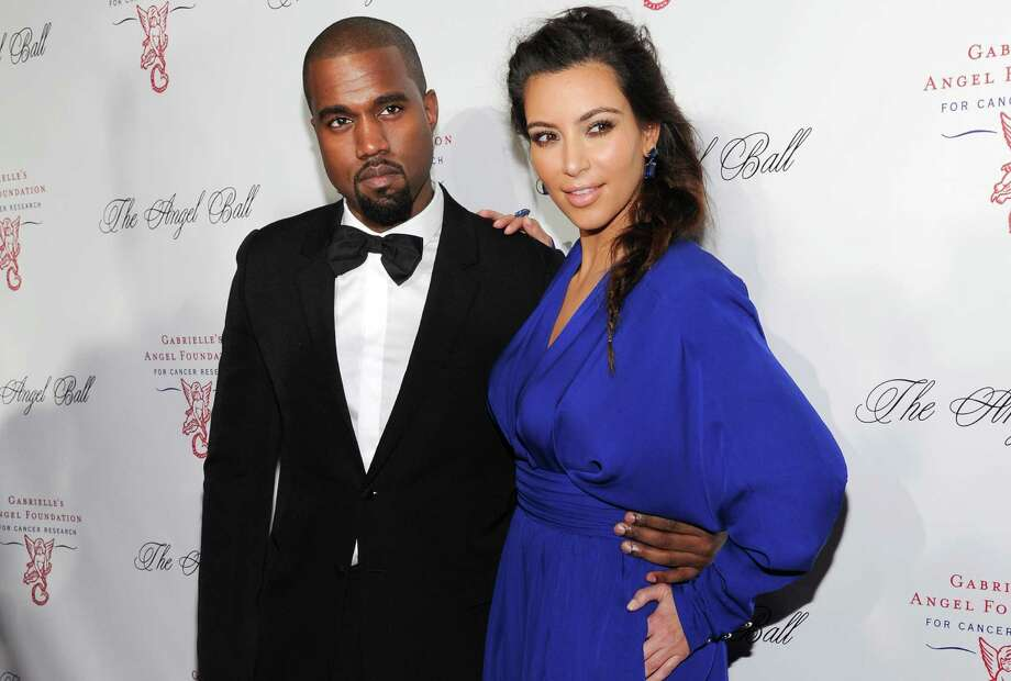 FILE - In this Oct. 22, 2012 file photo, singer Kanye West, left, and girlfriend Kim Kardashian attend Gabrielle's Angel Foundation 2012 Angel Ball cancer research benefit at Cipriani Wall Street in New York.  West and Kardashian sued YouTube co-founder Chad Hurley in Los Angeles on Thursday, Oct. 31, 2013, claiming he violated a confidentiality agreement by posting footage of West's elaborate marriage proposal on a new video-sharing site.  (Photo by Evan Agostini/Invision/AP, File) ORG XMIT: CAET318 Photo: Evan Agostini / Invision