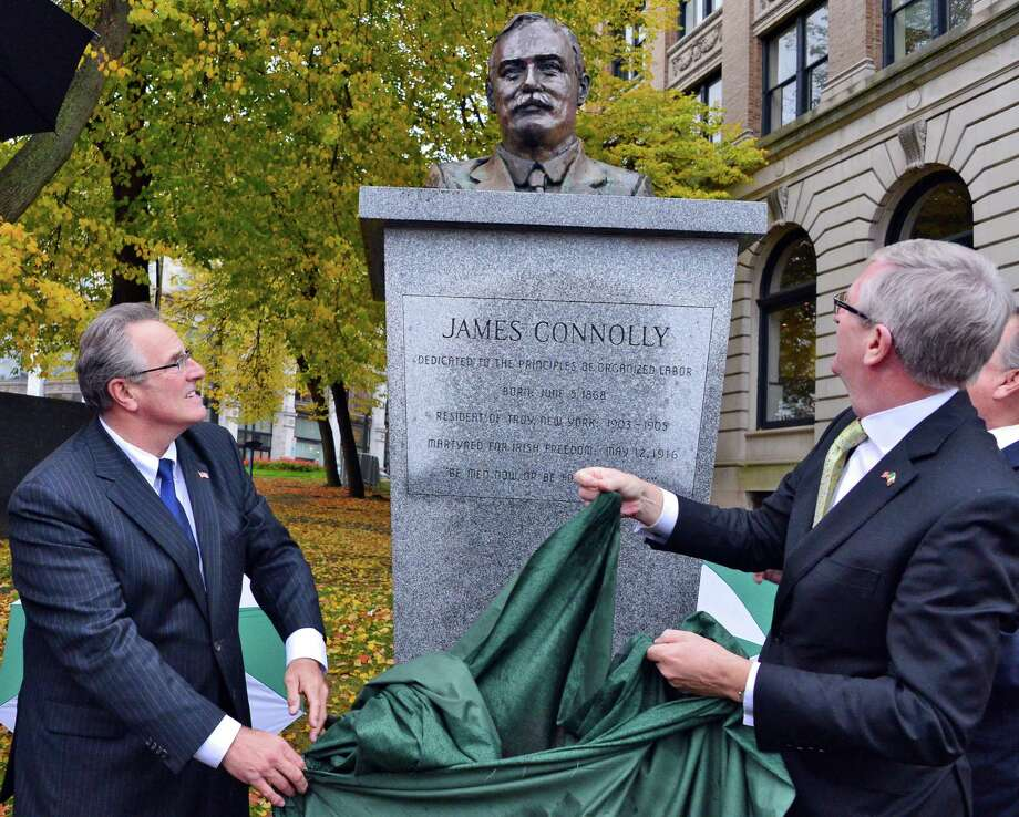 Troy Mayor Lou Rosamilia, left, and Ireland's Ambassador, Consul General Noel Kilkenny, rededicate the James Connolly Memorial in Riverfront Park Friday, Nov. 1, 2013, in Troy, NY.  (John Carl D'Annibale / Times Union) Photo: John Carl D'Annibale / 00024453A