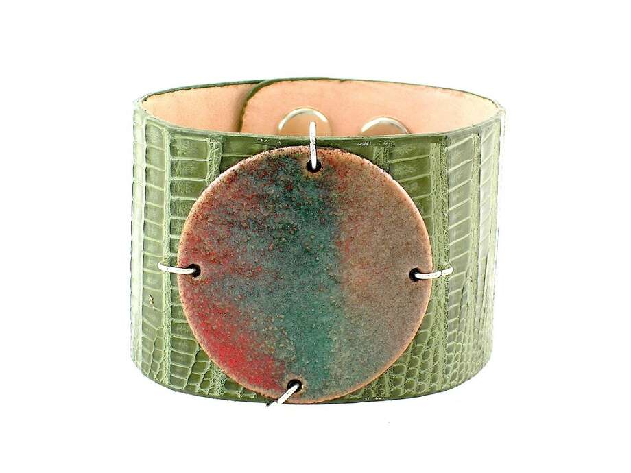 WILD SIDE An exotic-skin enamel cuff comes from Austin-based Leighelena; $125. Photo: Leighelena / ONLINE_YES