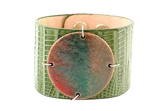 WILD SIDE An exotic-skin enamel cuff comes from Austin-based Leighelena; $125.
