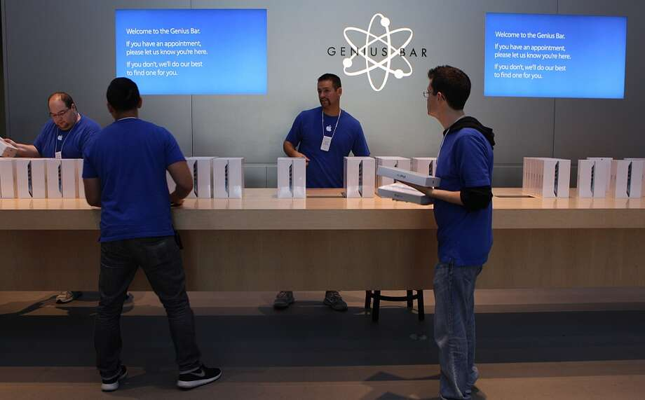 Apple employees have their stock of new IPad Air's ready at the Apple store on University Ave. in Palo Alto, California, on Friday, November 1, 2013, as it goes on sale today. Photo: Liz Hafalia, The Chronicle