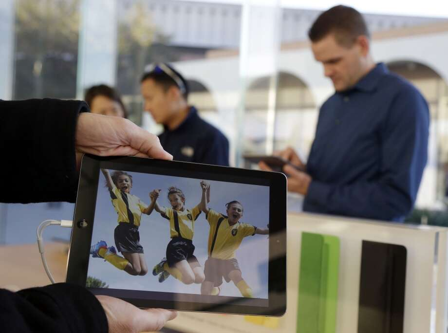 The new iPad Air is displayed on Friday, Nov. 1, 2013, in Stanford, Calif. Apple's iPad Air, a thinner, lighter and faster-running version of its previous large tablet computers, goes on sale Friday with a starting price of $499. The company also unveiled an updated version of its iPad Mini recently. It goes on sale sometime in November. (AP Photo/Marcio Jose Sanchez) Photo: Marcio Jose Sanchez, Associated Press