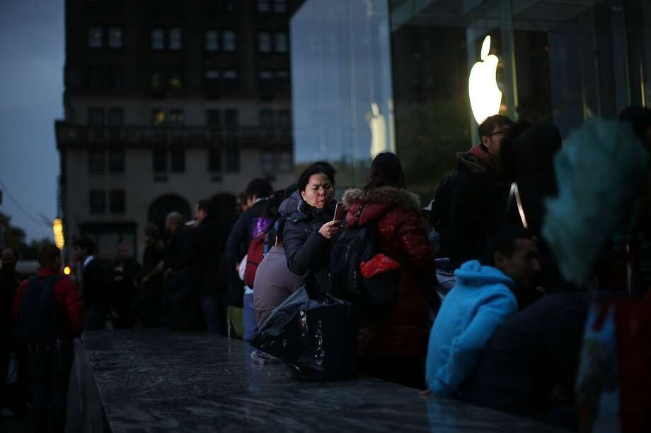 NEW YORK, NY - NOVEMBER 01: Some of the first customers wait in line at the Apple store to purchase the new iPad Air, the fifth generation of its tablet on November 1, 2013 in New York City. The new iPad, which will also come in a mini version, is 20% thinner and 28% lighter than the current fourth-generation iPad. It has the same 9.7-inch screen as previous iPads and uses the same A7 processing chip that's in the iPhone 5S. The iPad Air, which went on sale today, will start at $499 for a 16GB Wi-Fi-only model and go up to $629 for a 16GB with 4G LTE connectivity.  (Photo by Spencer Platt/Getty Images) Photo: Spencer Platt, Getty Images