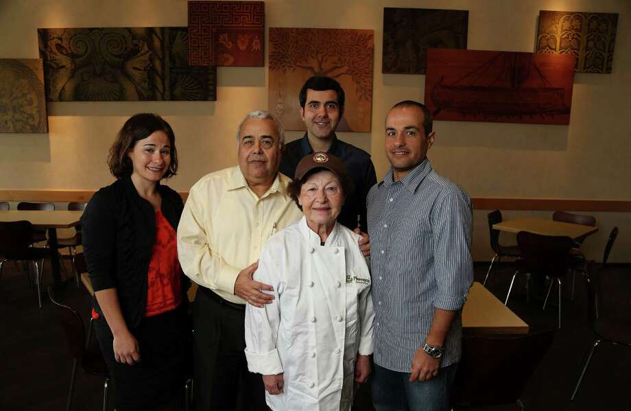 The Tcholakian family Ann-Marie, Zohrab and Arpi, and sons Haig and Raffi, far right  at Phoenicia Deli, Monday, Oct. 21, 2013, in Houston. Story is about the 30th anniversary of Phoenicia Specialty Foods, which was begun by Lebanese immigrants Zohrab and Arpi Tcholakian in 1983. The business, which now includes two enormous supermarkets boasting the city's largest assortment of imported foods, began with a single shawarma.( Karen Warren / Houston Chronicle ) Photo: Karen Warren, Staff / © 2013 Houston Chronicle