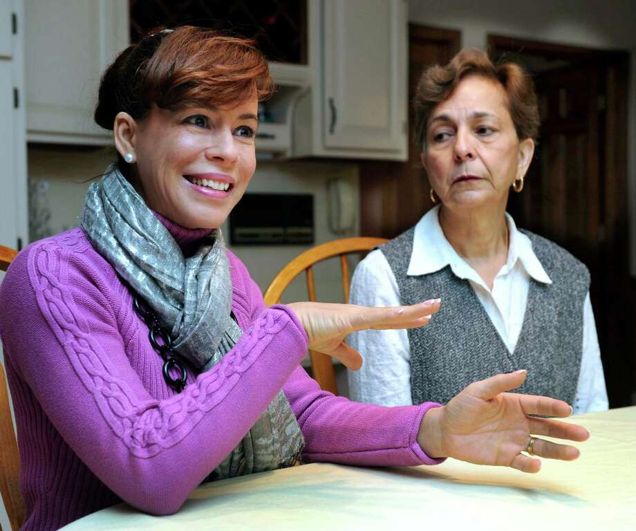 Eliette Matos, 43, of Bethel, left, and Ileana Velazquez, 64, of Danbury, talk about the Latino Scholarship Fund, Tuesday, Oct. 29, 2013. Photo: Carol Kaliff / The News-Times