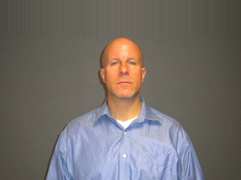 Glenn Mishuck, a teacher at Fairfield Ludlowe High School, has been charged with having a sexual relationship with an underage student. He was charged with 17 counts of second degree sexual assault. Photo: Fairfield Police, Fairfield Police Department / Connecticut Post