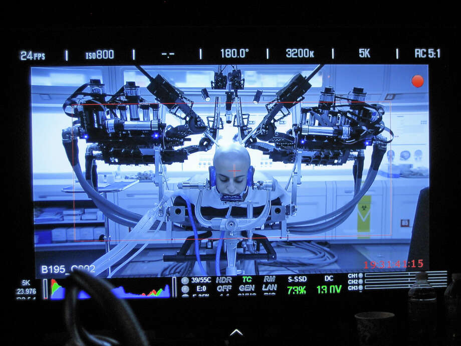 "The UW's Raven II robot as it simulates brain surgery on actor Moisés Arias during the filming of ""Ender's Game."" Photo: University Of Washington"