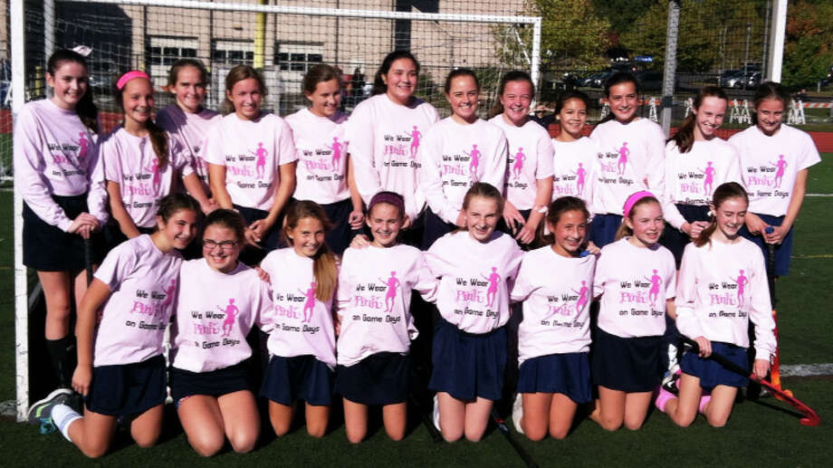 Fairfield PAL field hockey Team 1 wears pink, breast cancer awareness T-shirts designed by one of their players to raise funds for the Norma F. Pfriem Breast Care Centerís programs during the Play for the Cure fundraiser. Photo: Contributed Photo / Fairfield Citizen