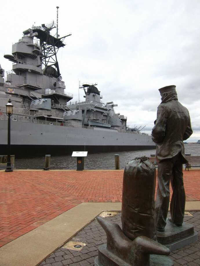 Stirring public art along Norfolk's waterfront includes The Lone Sailor, a commanding statue  dedicated to everyone who has served in the Navy. It faces the enormous Battleship Wisconsin.
