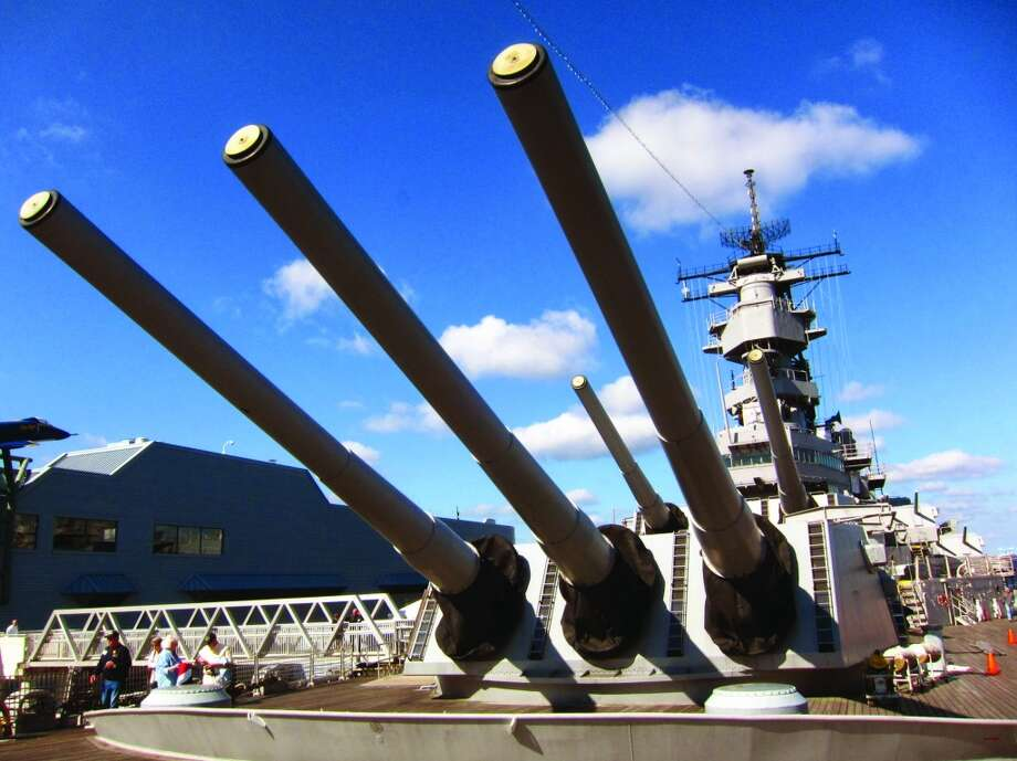 The Battleship Wisconsin dominates the waterfront of Norfolk. It's one of the largest battleships ever built by the U.S. Navy. Its guns could fire 2,700-pound armor-piercing projectiles up to 24 miles.