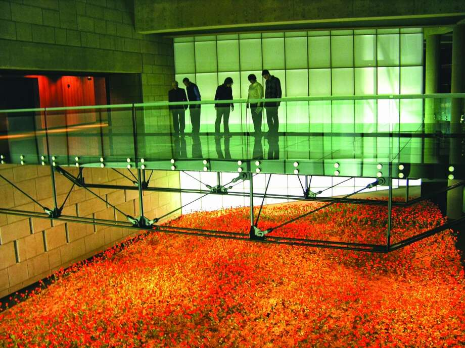 The Glass Bridge at the National World War I Museum crosses over a field of poppies representing the soldiers who gave their lives in the war. The museum is in the center of Kansas City.