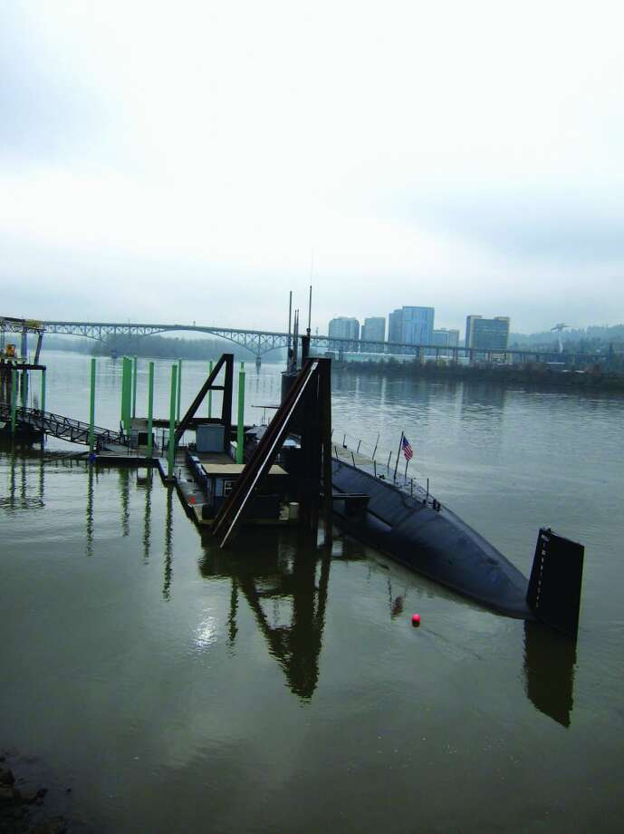 The USS Blackjack is docked next to the Oregon Museum of Science and Industry on the Willamette River in Portland, Ore.The retired wartime submarine is open for tours led by experts on such vessels.