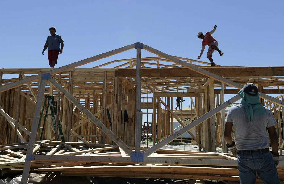 Men work on framing new houses in Odessa, the West Texas oil town where hundreds of residences are being built to accommodate the influx of people working in the oil fields. Photo: Pat Sullivan / Associated Press