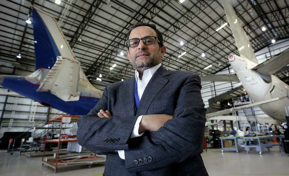 Mohammed Alzeer, general partner of Gore Design Completions Ltd., stands in front of an Airbus A320 (left) and A330. The aircraft-modification business recently won an international competition to perform completion work on two Boeing 787 Dreamliner aircraft. Photo: Bob Owen / San Antonio Express-News
