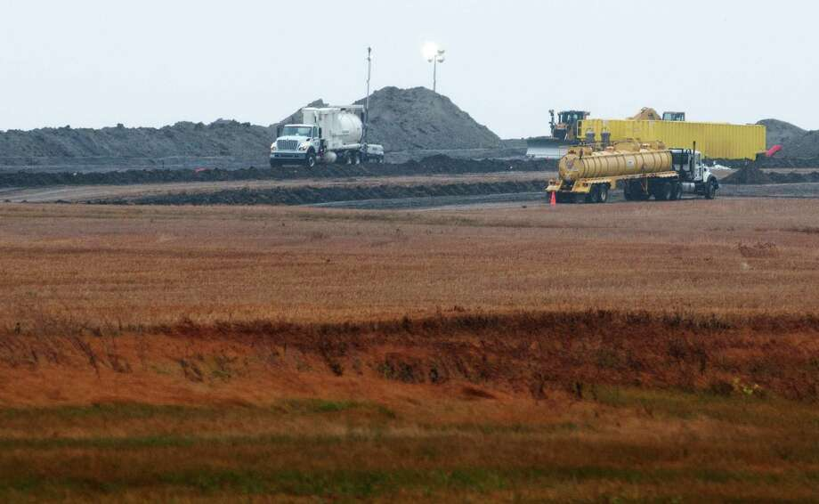 Less than a quarter of Tesoro's 20,600-barrel spill discovered Sept. 29 in a North Dakota field has been cleaned. Photo: Kevin Cederstrom / Associated Press
