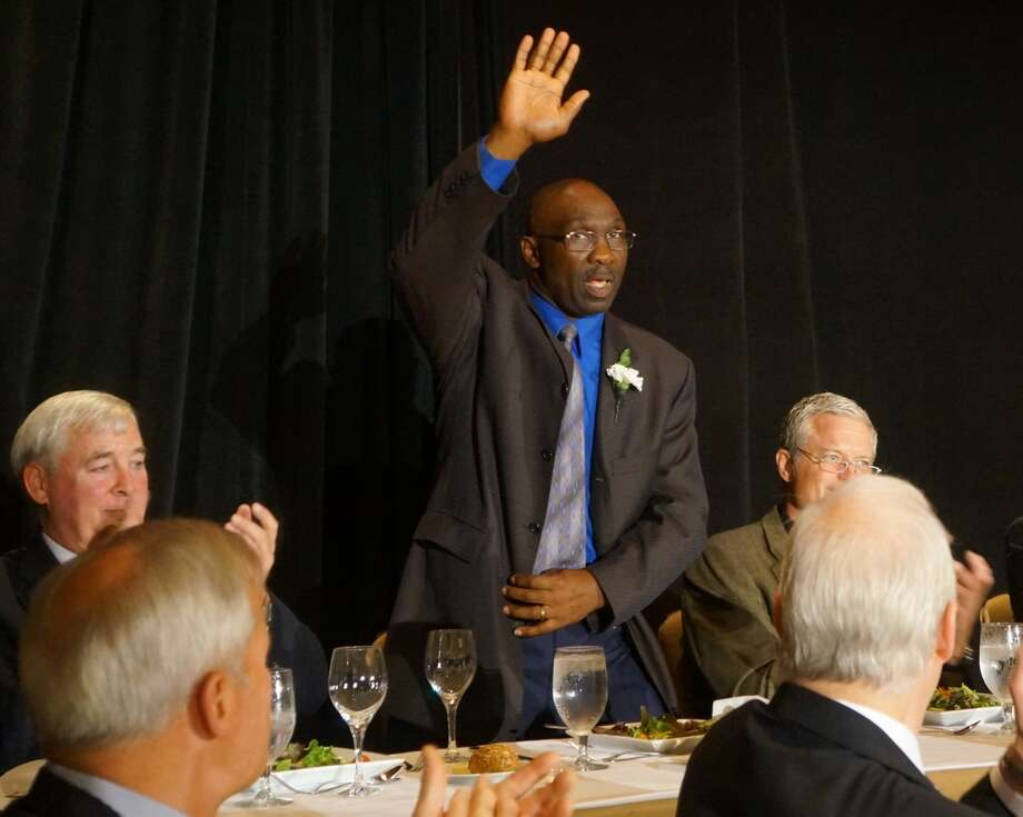 Former Mets star Mookie Wilson waves to attendees at The Greenwich Old Timers Athletic Association's 53rd Annual Sports Awards Dinner, held Friday at the Hyatt Regency Greenwich. At left, seated next to Wilson, is local honoree Ed Sinnott; at right is former Giants center Bart Oates, the event's other national honoree. Photo: Paul Schott, Greenwich Time / Greenwich Time