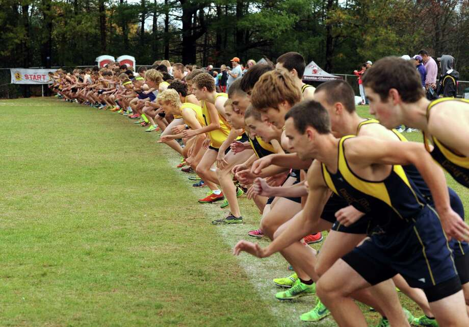 Runners break from the starting line during the boys' Class B Section II cross country championships at Queensbury High School on Thursday Nov. 1, 2013, in Queensbury, N.Y. (Michael P. Farrell/Times Union) Photo: Michael P. Farrell / 00024432A
