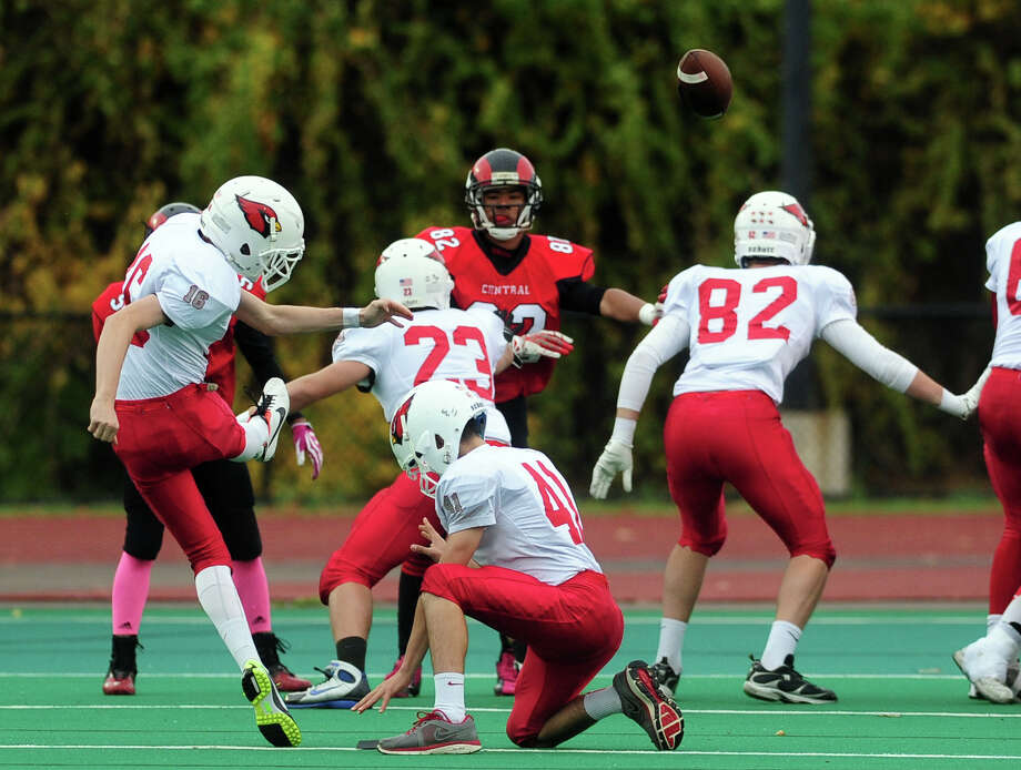 Greenwich's Peter Heerdt attempts a field goal, during high school football action against Central in Bridgeport, Conn. on Friday November 1, 2013. Photo: Christian Abraham / Connecticut Post