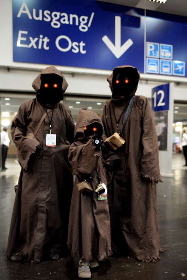 ESSEN, GERMANY - JULY 28:  Fans from all over the world pose wearing dressed as Star Wars characters during the Star Wars Celebration at Messe Essen on July 28, 2013 in Essen, Germany. Photo: Sascha Steinbach, Getty Images / 2013 Getty Images
