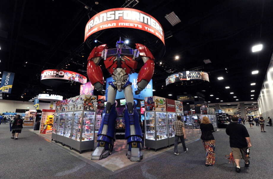SAN DIEGO, CA - JULY 14:  Hasbro booth with Transformers display during day 3 of Comic-Con International 2012 held at San Diego Convention Center on July 14, 2012 in San Diego, California. Photo: Albert L. Ortega, Getty Images / 2012 Albert L. Ortega