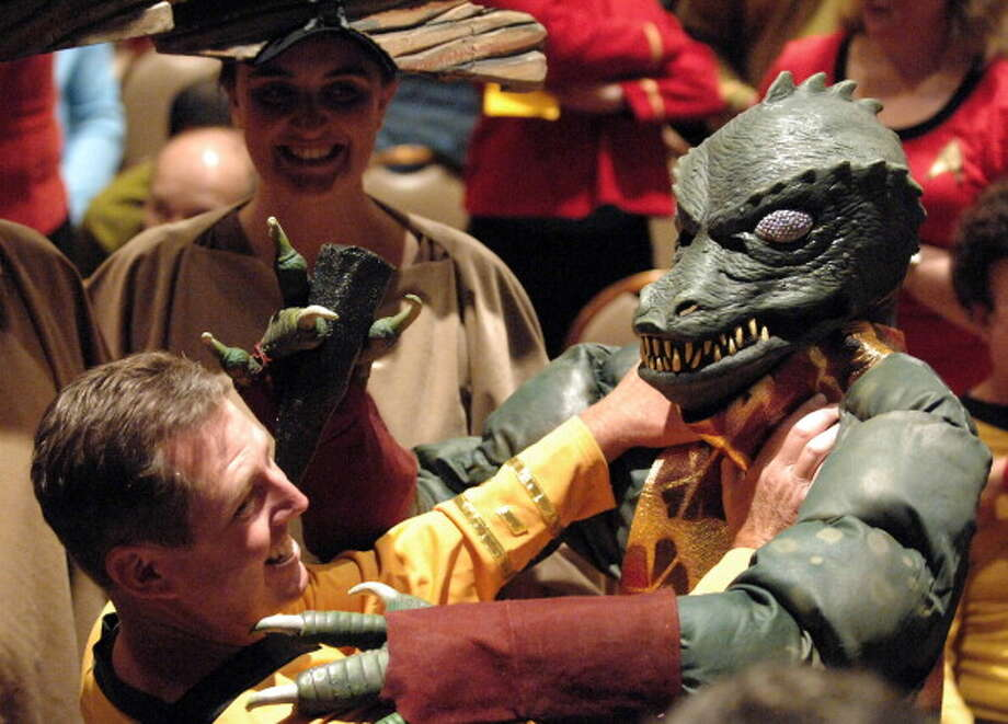 LAS VEGAS, NV - AUGUST 11:  Cosplayer dressed as Gorn and cosplayer dressed as Captain Kirk  participate in the 11th Annual Official Star Trek Convention - day 3 held at the Rio Suites and Hotel on August 11, 2012 in Las Vegas, Nevada. Photo: Albert L. Ortega, Getty Images / 2012 Albert L. Ortega
