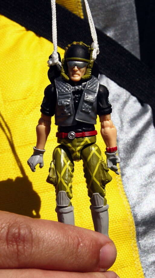 A convention-goer shows his G.I. Joe that parachuted from the roof of Disney's Dolphin hotel in Orlando, Florida, to celebrate the opening of G.I. Joecon, a convention dedicated to the military action figures, on Friday, April 1, 2011. The convention kicked off its weekend of festivities by dropping the action figures, with working parachutes, off of the roof of the hotel. Photo: Orlando Sentinel, Getty Images / 2011 MCT