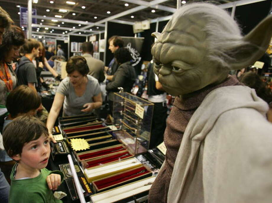 A young fan looks at a model of Yoda at the Celebration Europe Exhibition in Excel Centre on July 13, 2007 in London, England. The Star Wars Celebration Europe commemorates the first 30 years of the most successful film series to date. Photo: Cate Gillon, Getty Images / 2007 Getty Images
