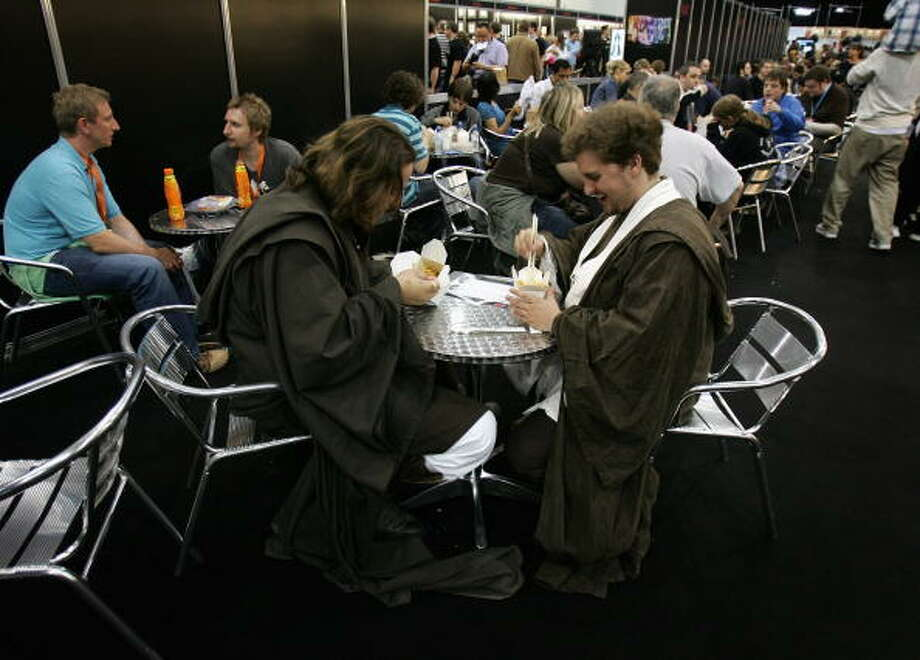 Star Wars fans eat noodles at the Star Wars Celebration Europe in the Excel centre on July 13, 2007 in London, England. The celebration is the largest of its kind in Europe. Photo: Chris Jackson, Getty Images / 2007 Getty Images