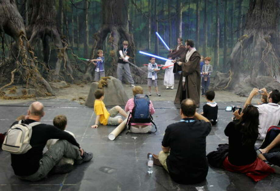 Children practice their light sabre skills at the Star Wars Celebration Europe in the Excel centre on July 13, 2007 in London, England. The celebration is the largest of its kind in Europe. Photo: Chris Jackson, Getty Images / 2007 Getty Images