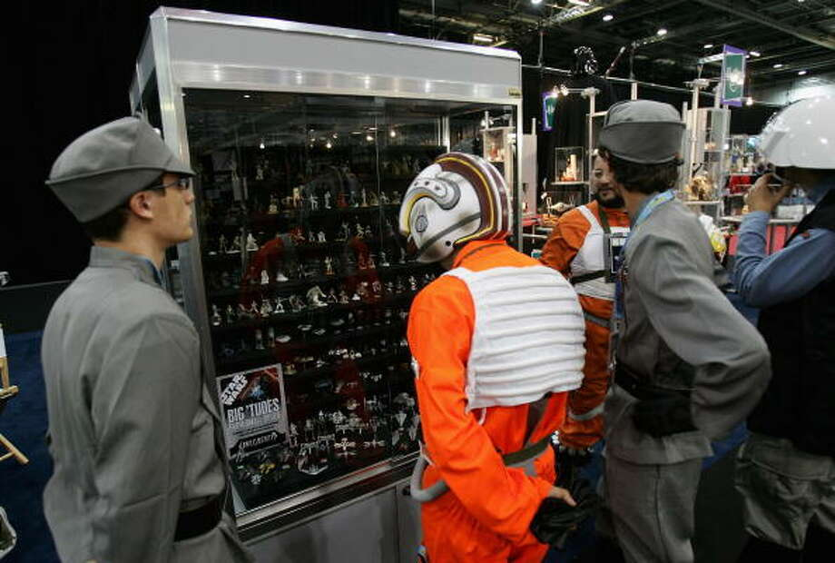 Men dressed as Star Wars Ccaracters browse memorabilia at the Star Wars Celebration Europe in the Excel centre on July 13, 2007 in London, England. The celebration is the largest of its kind in Europe. Photo: Chris Jackson, Getty Images / 2007 Getty Images
