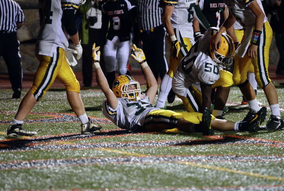 Trinity Catholic's Thomas Costigan (32) celebrates a touchdown during the football game against Stamford at Stamford High School's Boyle Stadium on Friday, Nov. 1, 2013. Photo: Amy Mortensen / Connecticut Post Freelance