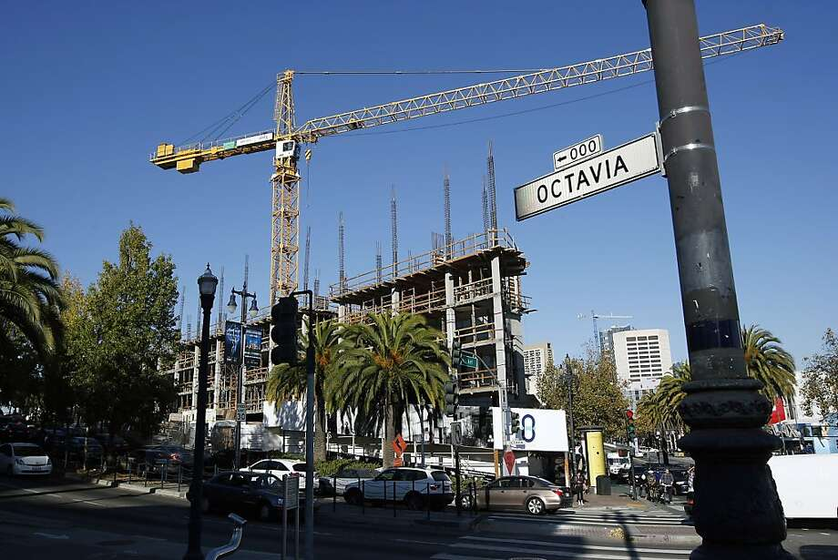 A 113-unit apartment building taking shape at Market Street and Octavia Boulevard is scheduled to open in January. Photo: Michael Short, The Chronicle