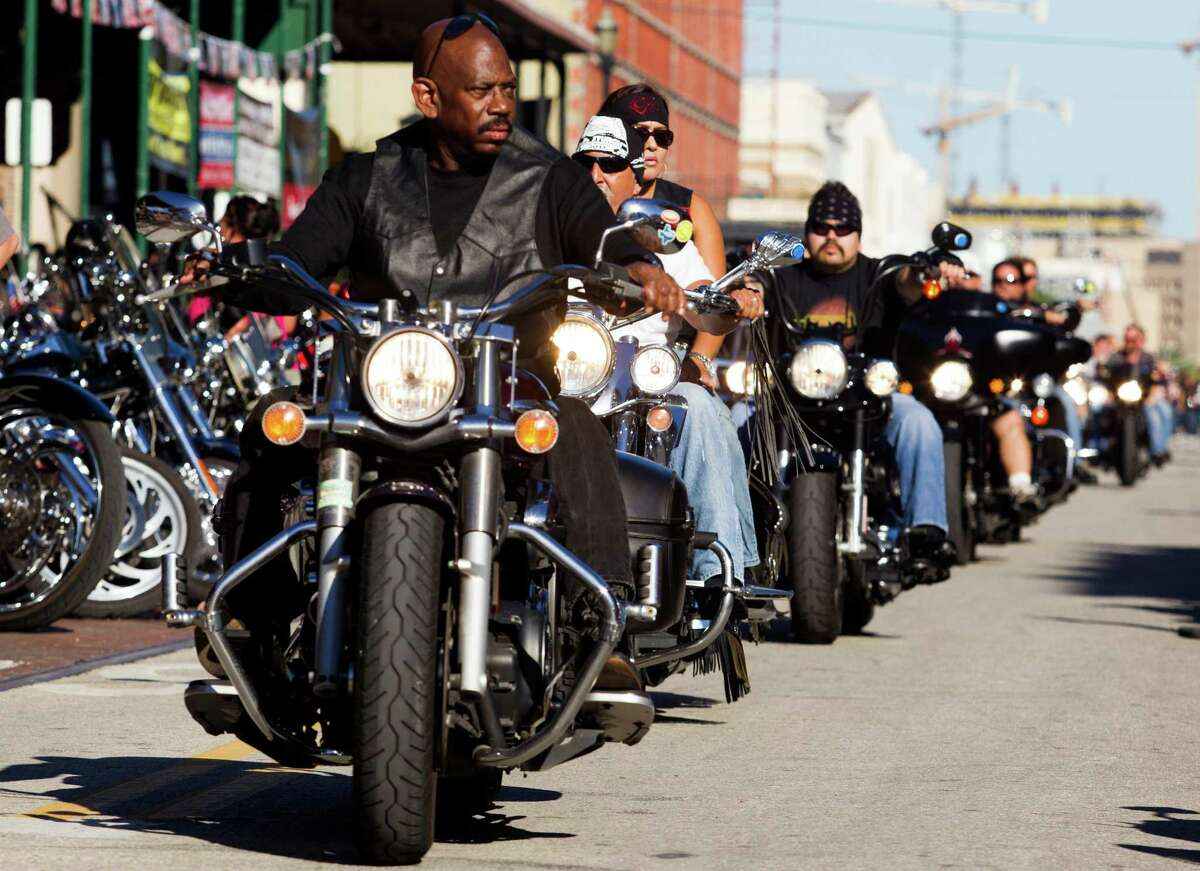 Bikers ride along the Strand during the 2013 Lone Star Rally on Friday, Nov. 1, 2013, in Galveston. Tens of thousands of motorcycle enthusiasts will roll into Historic Galveston for four days of free concerts, showcasing local and regional bands from across Texas and the Southwest.
