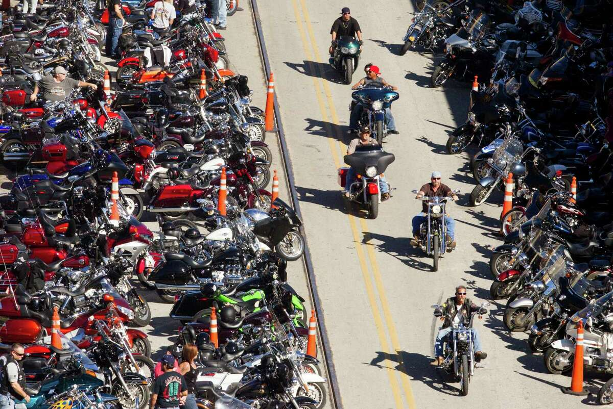 Bikers ride along strand during the 2013 Lone Star Rally on Friday, Nov. 1, 2013, in Galveston.