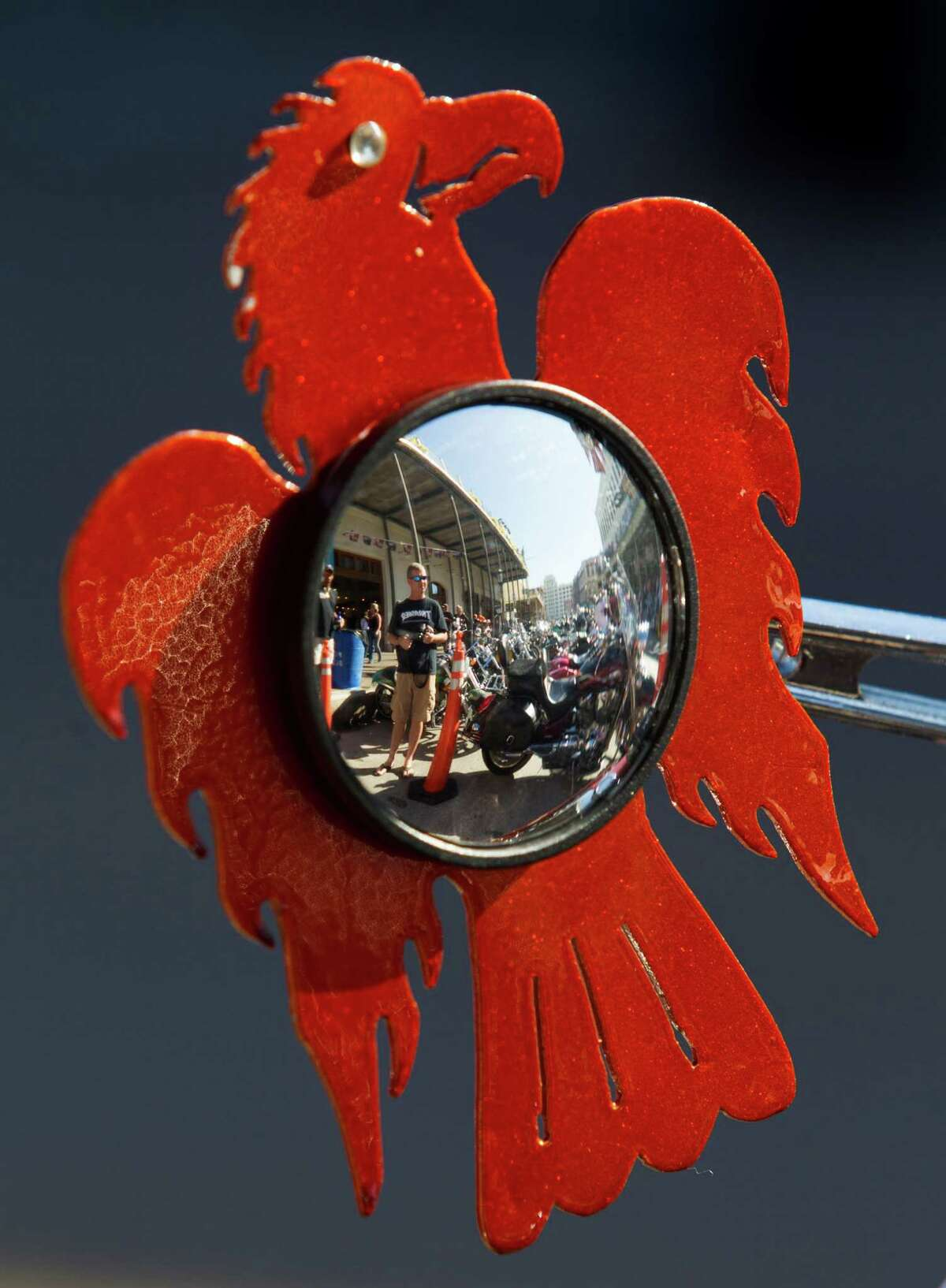 A motorcycle mirror is decorated as a Phoenix during the 2013 Lone Star Rally on Friday, Nov. 1, 2013, in Galveston.