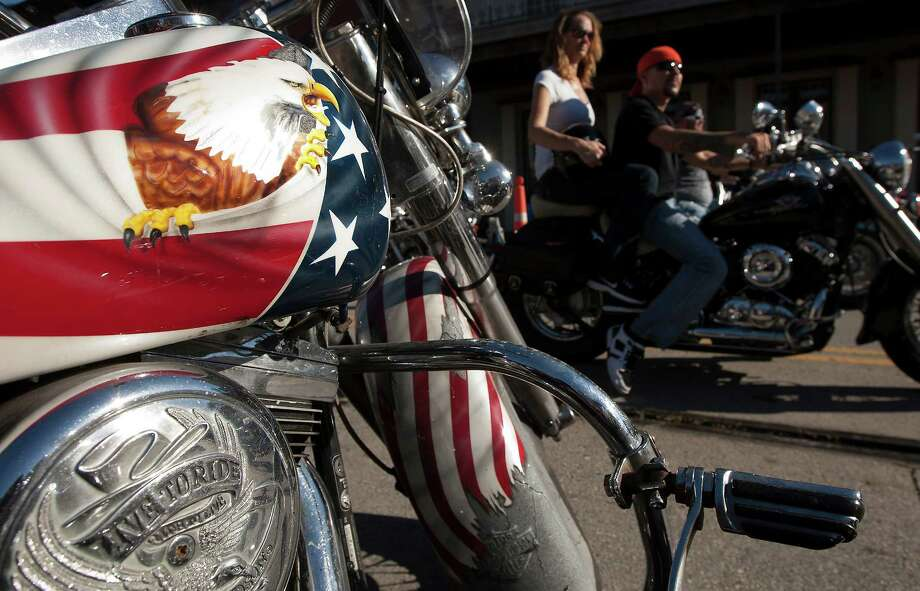 A Bald Eagle is painted on a Harley Davidson as bikers ride along the Strand during the 2013 Lone Star Rally on Friday, Nov. 1, 2013, in Galveston. Photo: J. Patric Schneider, For The Chronicle / © 2013 Houston Chronicle