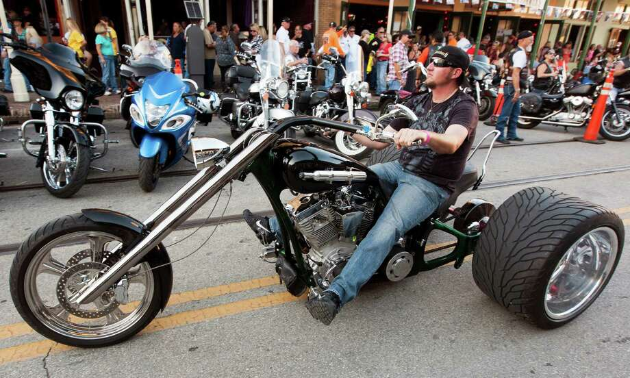 Dickerson resident Cole Crisp rides on his custom built bike on the Strand during the 2013 Lone Star Rally on Friday, Nov. 1, 2013, in Galveston. Photo: J. Patric Schneider, For The Chronicle / © 2013 Houston Chronicle