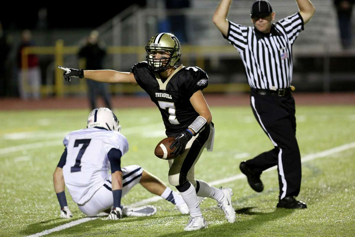 Trumbull High School's #7 Thomas Hayduk celebrates after a 37 yard first down reception against Staples High School on Friday evening.
