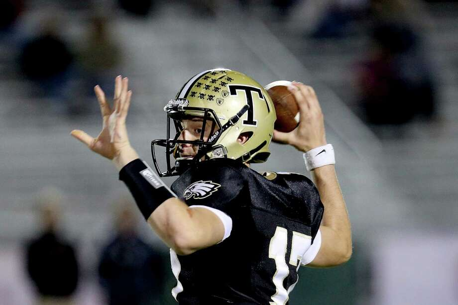 Trumbull High School's quarterback #17 Nick Roberts looks for an open receiver down field during Friday evening match-up against Staples High School. Photo: Mike Ross / Mike Ross Connecticut Post freelance - @www.mikerossphoto.com
