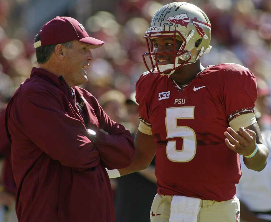 QB Jameis Winston, chatting with assistant Tim Brewster last week, has led Florida State to TDs in 54.2 percent of its drives. Photo: Phil G. Sears / Associated Press
