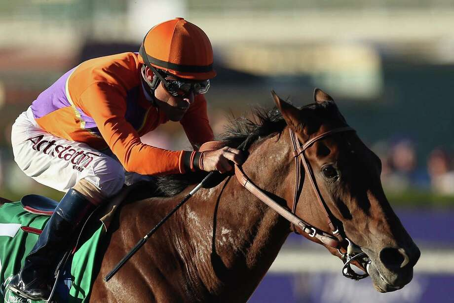 Gary Stevens, 50, rides atop Beholder en route to winning the Distaff on Friday in Arcadia, Calif. Photo: Jeff Gross, Staff / 2013 Getty Images