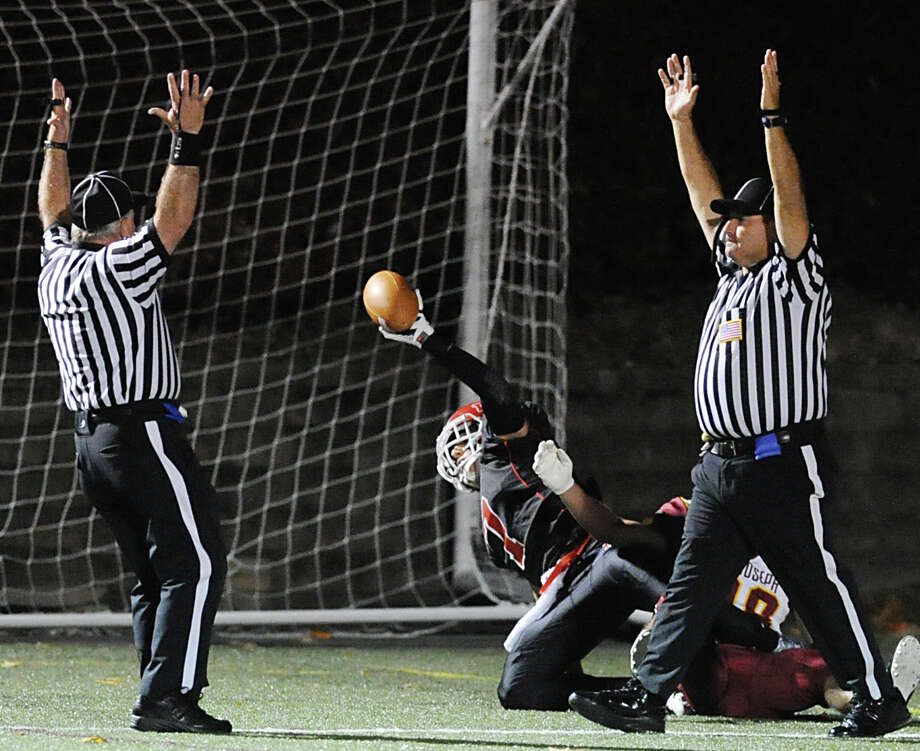 New Canaan wide receiver Alex LaPolice shows the ball and both refs signal touchdown after LaPolice made a first quarter catch off a Nick Cascione pass during the High School football game between New Canaan High School and St. Joseph High School at New Canaan, Friday, Nov. 1, 2013. Photo: Bob Luckey / Greenwich Time