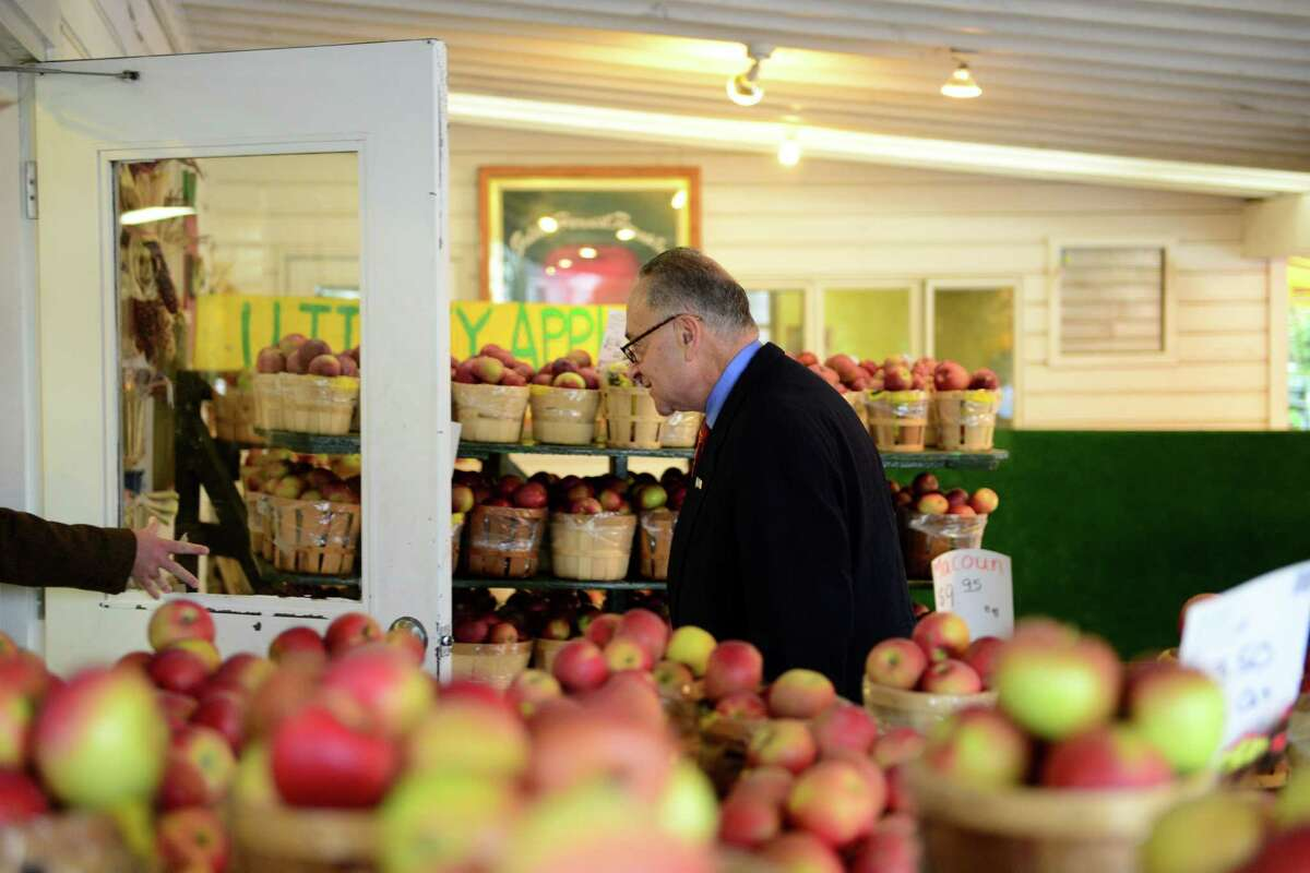 Sen. Charles Schumer enters Golden Harvest Farms Friday, Nov. 1, 2013, in Valatie, N.Y. Sen. Schumer came to Golden Harvest to promote his CIDER Act legislation, which would lower the tax rate that hard cider is calculated at. The CIDER Act would bring hard cider into the same tax rate as beer. It is currently taxed at a higher rate which is comparative to wine. (Will Waldron/Times Union)