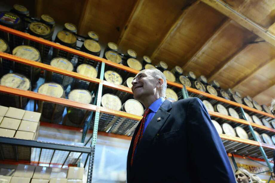 Sen. Charles Schumer is given a tour of Harvest Spirts Distillery Friday, Nov. 1, 2013, at Golden Harvest Farms in Valatie, N.Y. Sen. Schumer came to Golden Harvest to promote his CIDER Act legislation, which would lower the tax rate that hard cider is calculated at. The CIDER Act would bring hard cider into the same tax rate as beer. It is currently taxed at a higher rate which is comparative to wine. (Will Waldron/Times Union) Photo: WW / 00024487A
