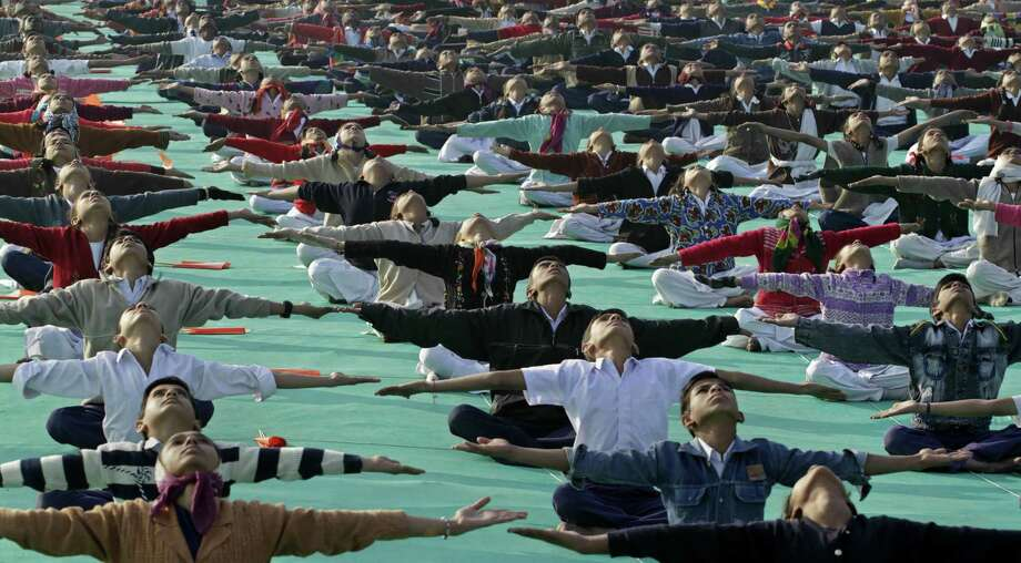 Indian schoolchildren practice yoga in Ahmadabad in 2011. Petitioners want India's top court to direct all schools run or funded by the federal government to include yoga as a subject. Photo: Associated Press File Photo